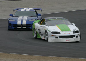 Randy Mackintosh driving his ITE Camaro at Laguna Seca